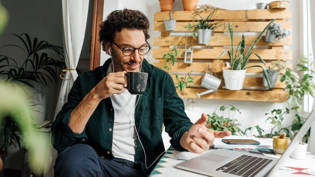 Man with laptop working remotely